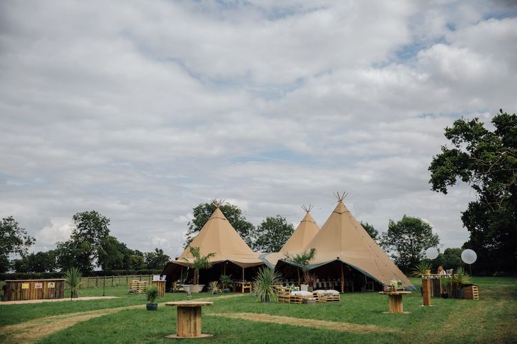 Outdoor Wedding Ceremony & Tipi Reception Planned by Benessamy Events | Red on Blonde Photography