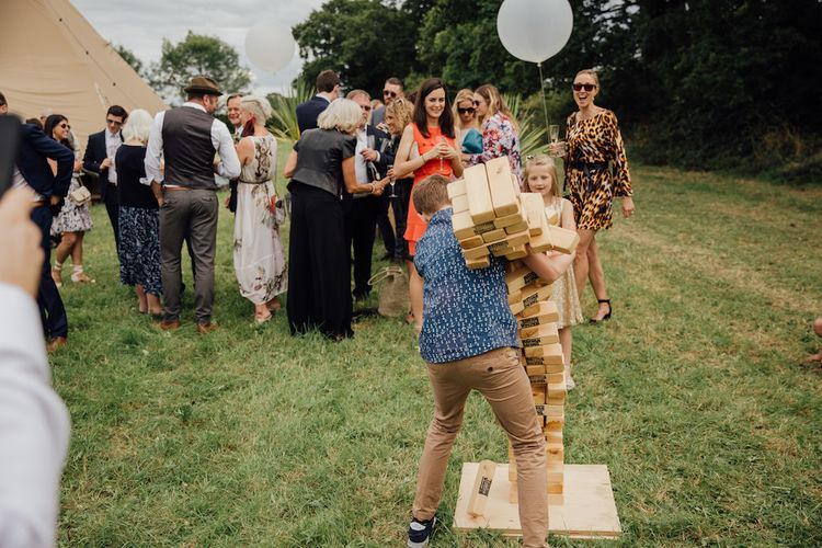 Giant Jenga Bridal Games | Outdoor Wedding Ceremony & Tipi Reception Planned by Benessamy Events | Red on Blonde Photography