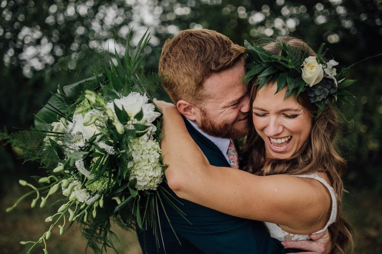 White & Green Bouquet | Bride in La Sposa Gown from Mirror Mirror Bridal | Groom in Paul Smith Suit | Outdoor Wedding Ceremony & Tipi Reception Planned by Benessamy Events | Red on Blonde Photography