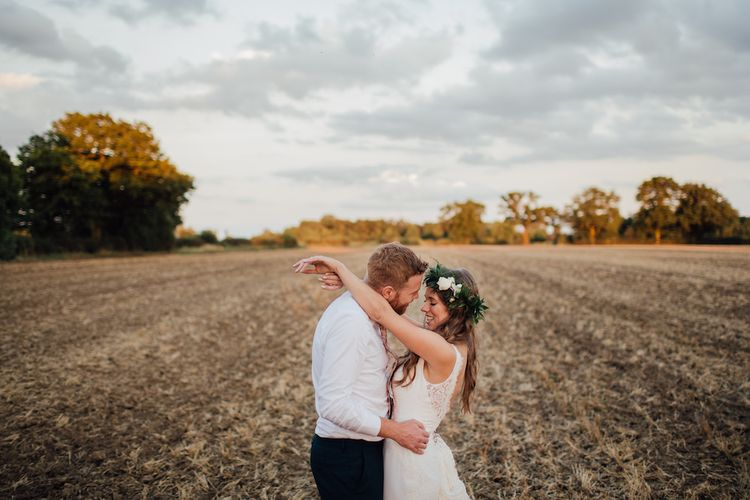 Bride in La Sposa Gown from Mirror Mirror Bridal | Groom in Paul Smith Suit | Outdoor Wedding Ceremony & Tipi Reception Planned by Benessamy Events | Red on Blonde Photography