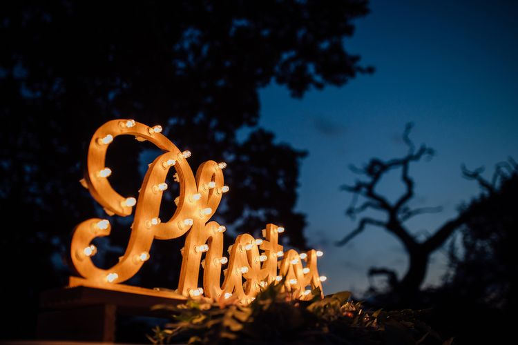 Photo Booth Light Up Letter Sign | Outdoor Wedding Ceremony & Tipi Reception Planned by Benessamy Events | Red on Blonde Photography