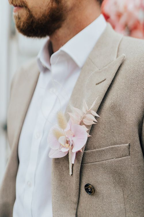 Delicate buttonhole for wedding with pink colour scheme