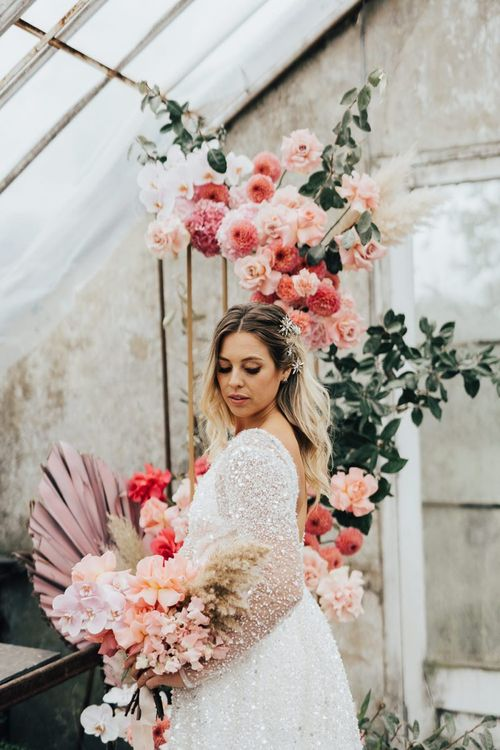 Bride in sparkling bridal gown at for wedding with pink colour scheme