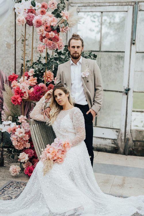Bride and groom portrait at Dream Capture Workshop with pink colour scheme