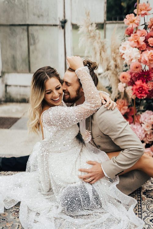 Fun bride and groom portrait for pink colour scheme wedding inspiration
