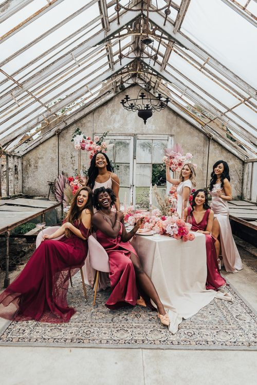 Intimate bridal party portrait in a conservatory