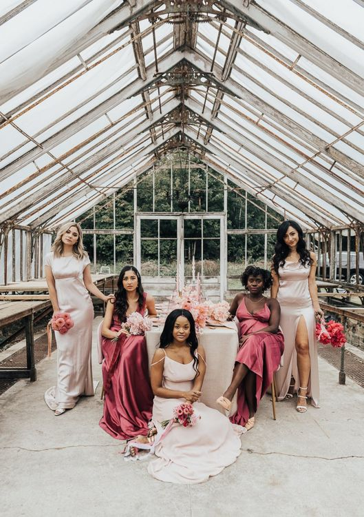 Bridesmaids in ombre pink dresses for intimate wedding with pink colour scheme