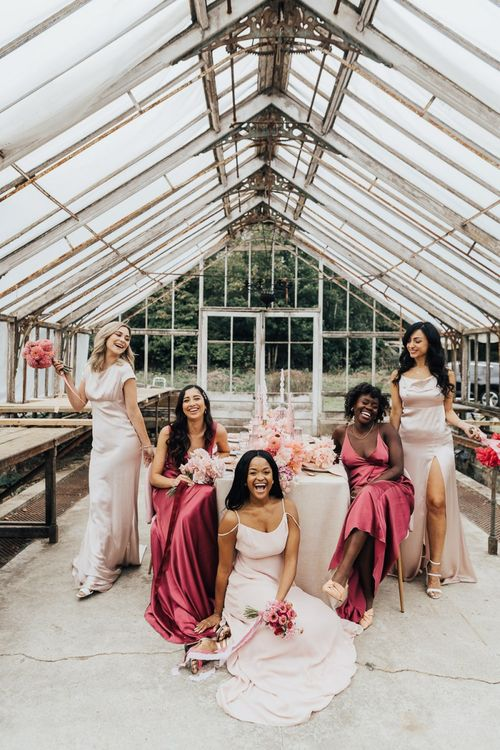 Bridal party portraits with bridesmaids in different shades of pink satin dresses