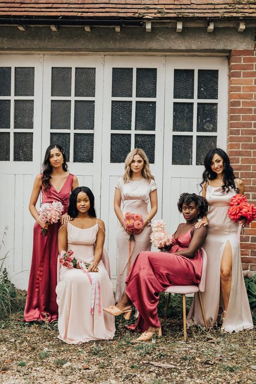 Bridesmaids in pink satin dresses by Constellation Âme