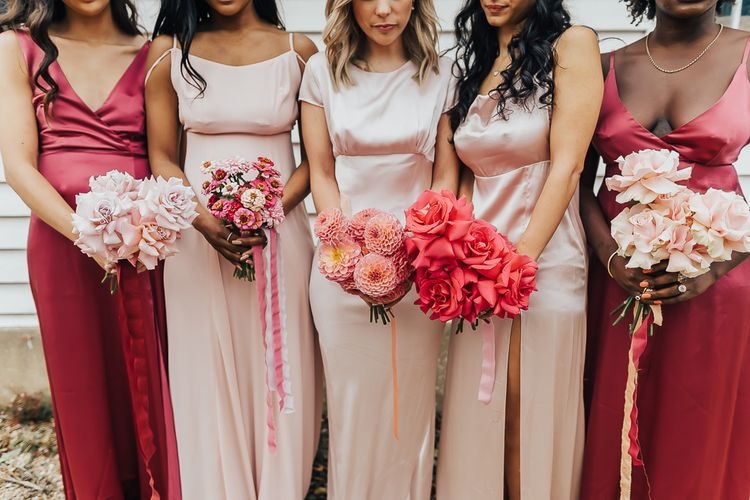 Bridesmaids posies with dahlias, roses and wild flowers for wedding with pink colour scheme