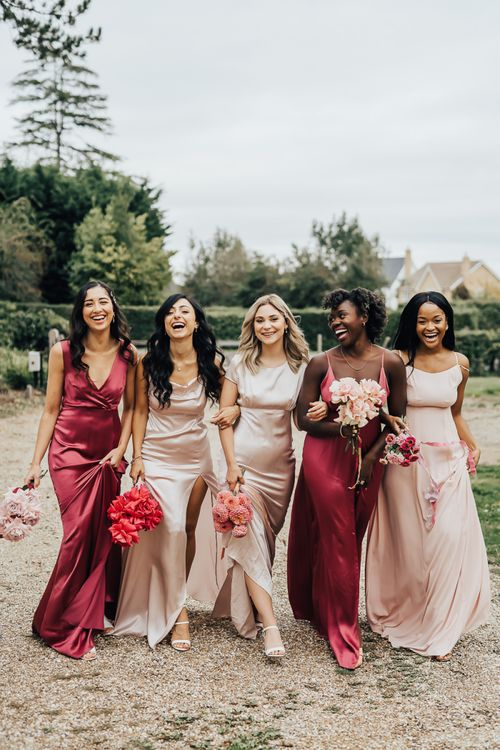 bridesmaids in satin dress for wedding with pink colour scheme