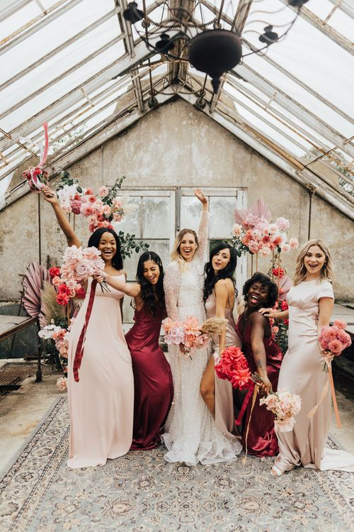 Fun bridal party portrait by Rebecca Carpenter Photography for intimate wedding with pink colour scheme