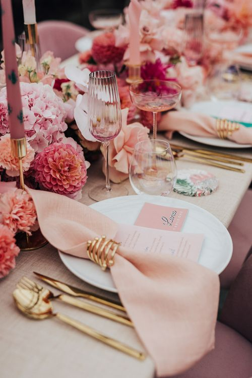 Table setting decor for wedding with pink colour scheme