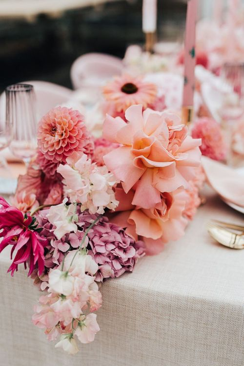 Romantic blush pink and peach wedding flower centrepiece for intimate wedding with pink colour scheme