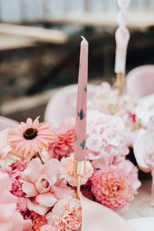Taper candles with cactus motifs for intimate wedding with pink colour scheme