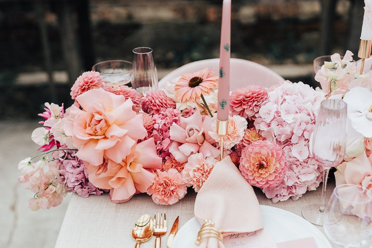 Wedding reception table flowers with dahlias, roses, hydrangeas and carnations