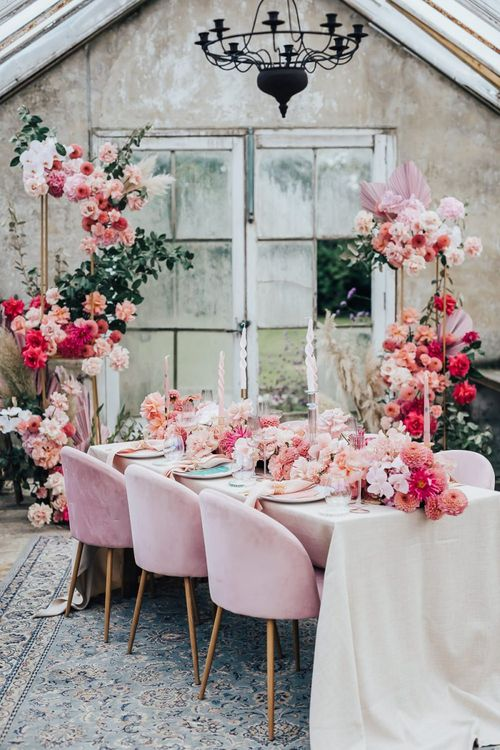 tablescape styling with velvet chairs, floral table runner and linens in pink colour scheme