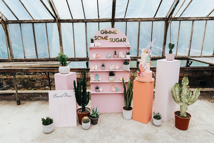Wedding cake and biscuit display in a conservatory