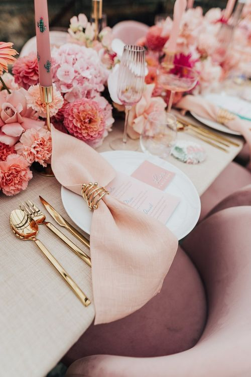 pink colour scheme place setting with blush flowers and gold cutlery