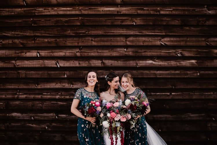 Bride With Bridesmaids In Floral Dresses And Pink Flower Bouquets
