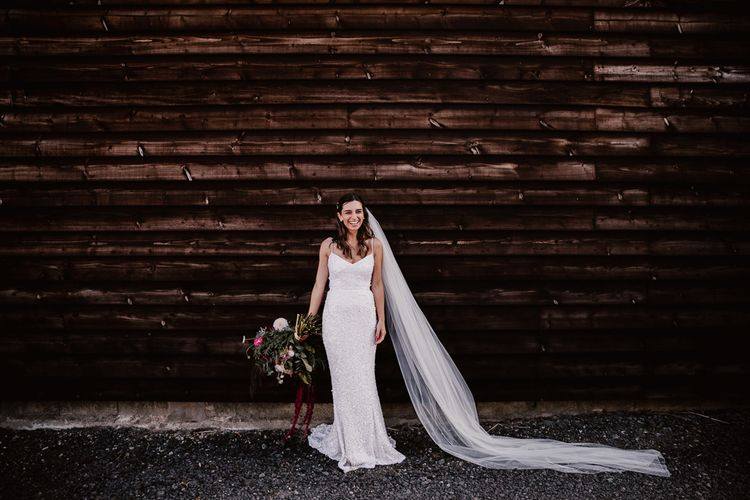 Bride With Long Veil and Pink Bouquet