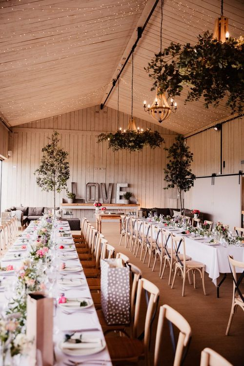 Wedding Table Decor With Foliage Chandelier And Wedding Lights