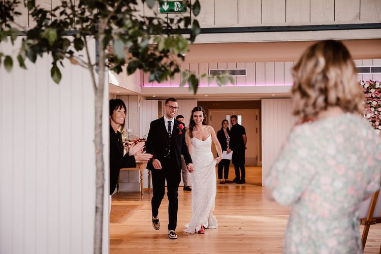 Bride and Groom Entering The Reception