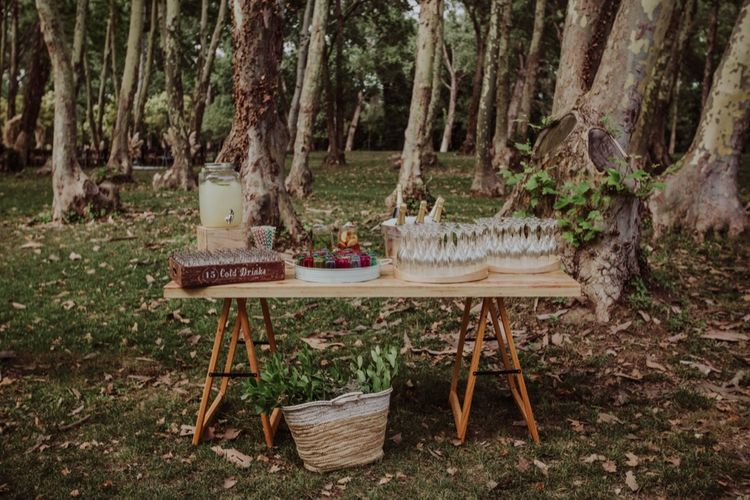 Drinks Station with Drinks Dispenser | Woodland Wedding at Sa Farinera de Sant LLuis Wedding Venue, Catalan Empordà, Spain | Planned & Styled by Mille Papillons | HUMà06 Photography | HUMà06 Photography