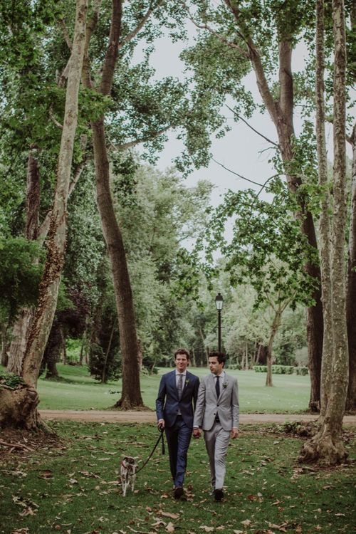 Outdoor Wedding Ceremony | Two Grooms Walking up the Aisle |  Woodland Wedding at Sa Farinera de Sant LLuis Wedding Venue, Catalan Empordà, Spain | Planned & Styled by Mille Papillons | HUMà06 Photography | HUMà06 Photography