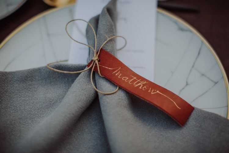 Leather Name Place Tag | Outdoor Woodland Wedding at Sa Farinera de Sant LLuis Wedding Venue, Catalan Empordà, Spain | Planned & Styled by Mille Papillons | HUMà06 Photography | HUMà06 Photography