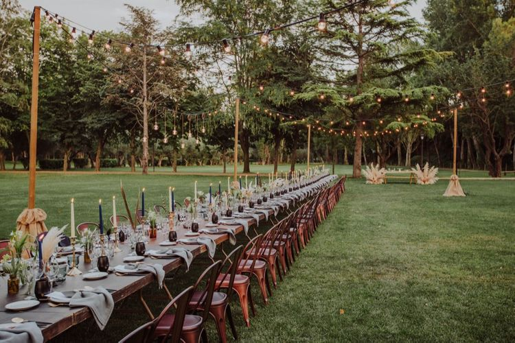 Al Fresco Long Trestle Tablescape with Festoon Lights | Outdoor Woodland Wedding at Sa Farinera de Sant LLuis Wedding Venue, Catalan Empordà, Spain | Planned & Styled by Mille Papillons | HUMà06 Photography | HUMà06 Photography