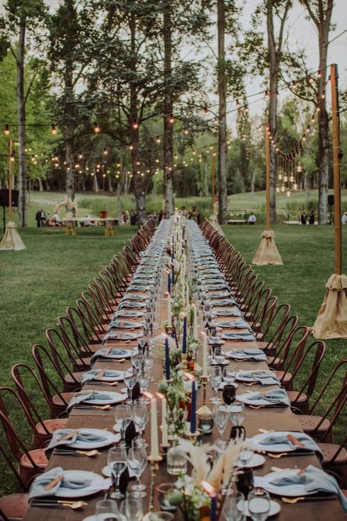 Tapper Candles, Grey Napkins, Black Glasses Table Decor | Outdoor Woodland Wedding at Sa Farinera de Sant LLuis Wedding Venue, Catalan Empordà, Spain | Planned & Styled by Mille Papillons | HUMà06 Photography | HUMà06 Photography