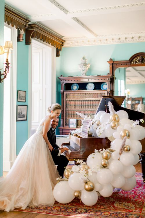White and gold balloon wedding decor at Prestwold Hall