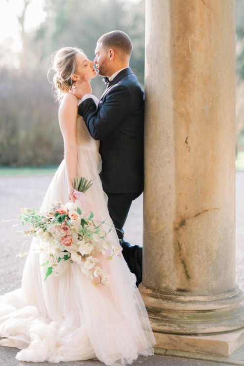 Bride and groom kissing at Leicestershire wedding venue