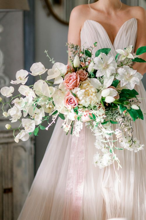 Romantic peach and white wedding bouquet with orchids for Prestwold Hall wedding