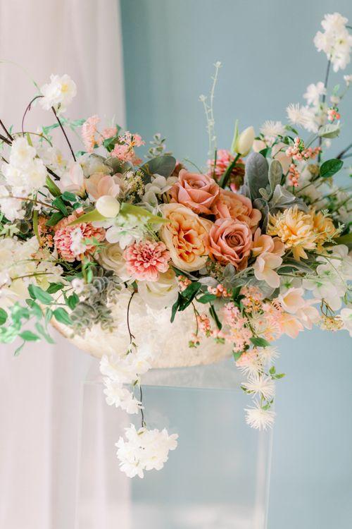 Peach and coral wedding flower arrangement