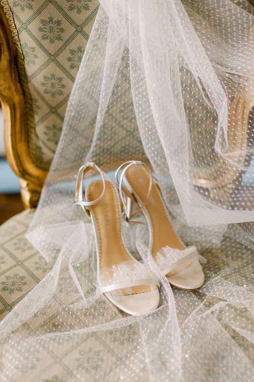 Polka dot wedding veil and strappy sandals