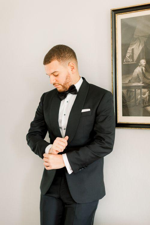 Elegant groom in black tie
