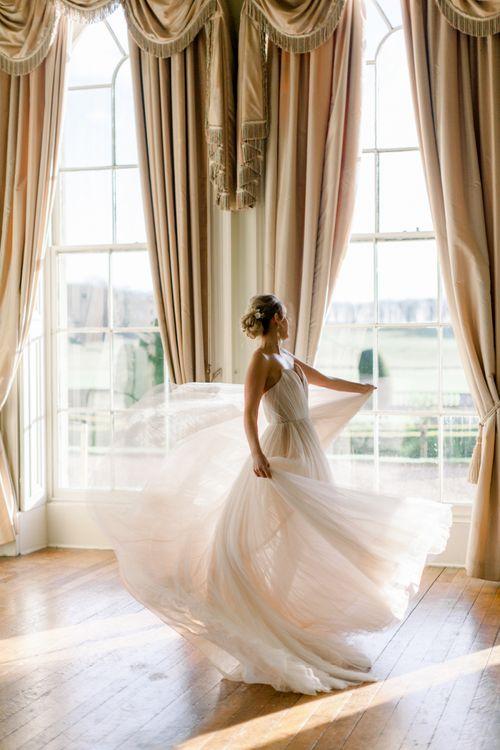Bride in sweetheart neckline wedding dress twirling