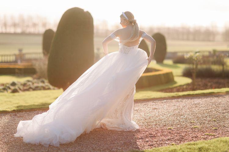 Golden hour portrait with bride in blush tulle wedding dress