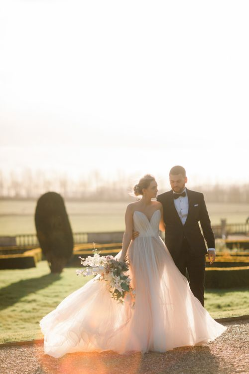 Sunset portrait with bride and groom in black tie attire