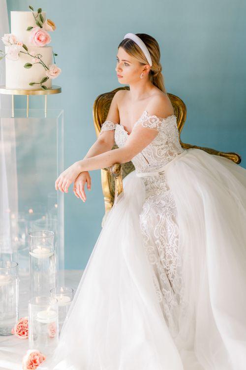 Bride in Bardot wedding dress with detachable skirt