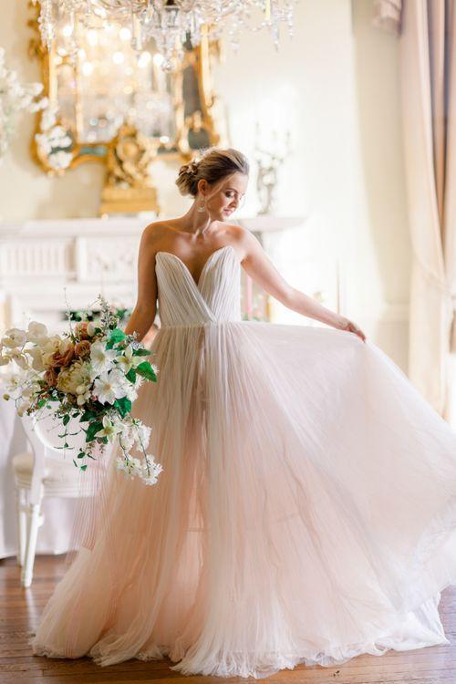 Blush pink off shoulder wedding dress