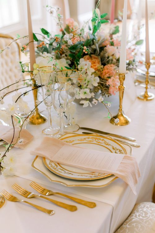 Place setting with gold cutlery and tableware