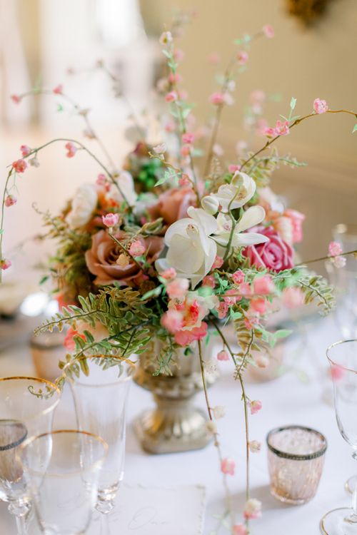 Orchids and dusky pink roses