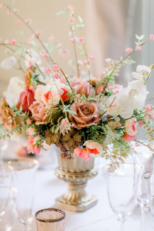 Vintage pink rose wedding flower centrepiece