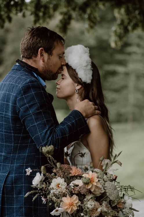 Groom in Blue Check Blazer Kissing HIs Brides Forehead