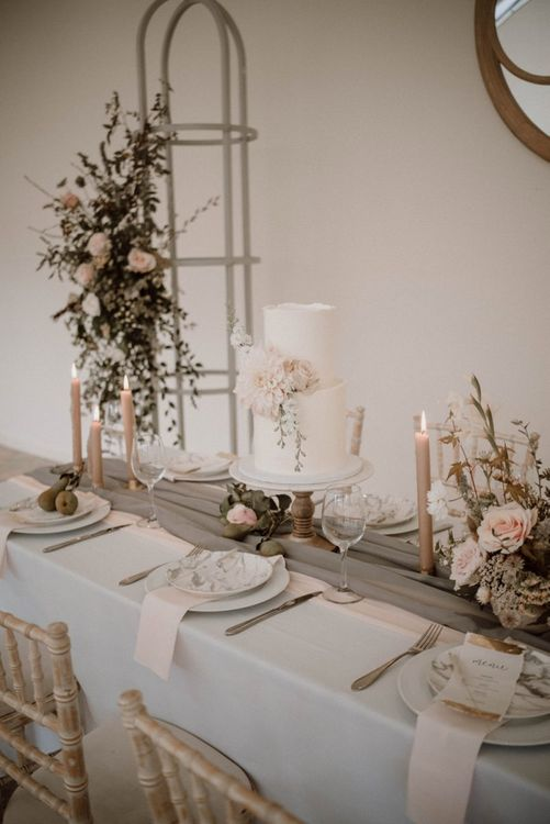 Romantic Blush Pink, White and Grey Tablescape with Two Tier Wedding Cake and Candles