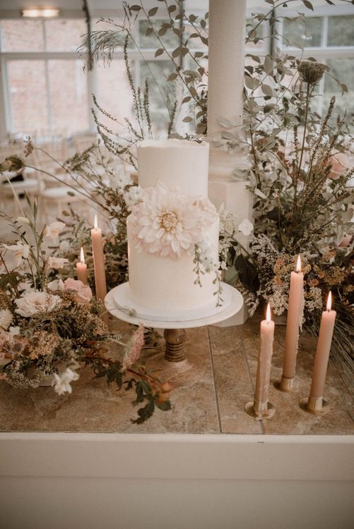 Two Tier Wedding Cake with Giant Dahlia Decor, Candles and Floral Arrangements
