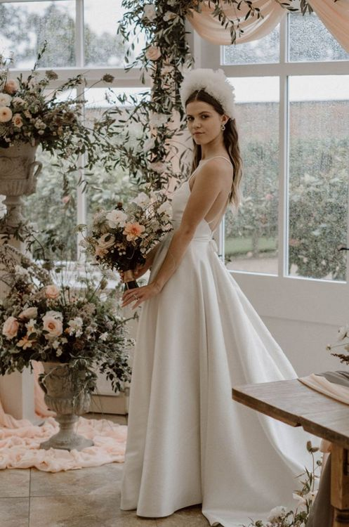 Bride in Emma Beaumont Wedding Dress with Thin Straps and White Headdress
